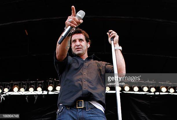 Lead singer of Creed Scott Stapp performs on stage prior to the NASCAR Sprint Cup Series AllStar Race at Charlotte Motor Speedway on May 22 2010 in...