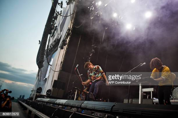 Lead singer of French band Phoenix Thomas Mars performs during the 11th Alive Festival in Oeiras near Lisbon on July 6 2017 / AFP PHOTO / PATRICIA DE...