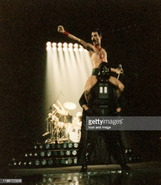 Lead singer of Queen Freddie Mercury sits on the shoulders of Star Wars character Darth Vader during The Game Tour September 20 at Joe Louis Arena in...