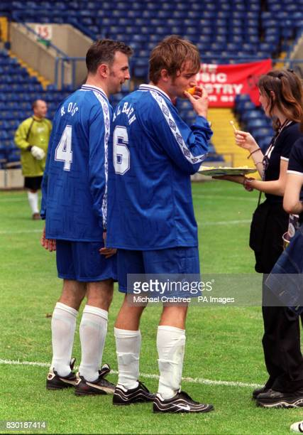 Lead Singer of the band Blur Damon Albarn eating an orange at the Music Industry Soccer Six celebrity football tournament at Stamford Bridge