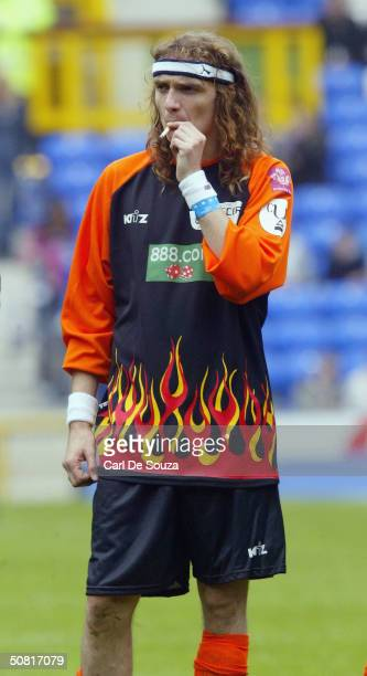 Lead Singer of the Rock Band The Darkness Justin Hawkins smokes a cigarette while watching the annual Music Industry Soccer Six fundraising...