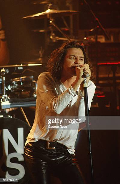 Lead singer of the rock group INXS, Michael Hutchence, belts out a song during a 1991 West Hollywood, California, concert at the Whiskey. Hutchence...
