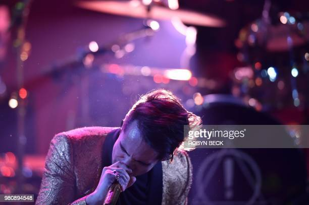 Lead singer of US band Panic At The Disco Brendon Urie performs on stage at the iHeartRadio Album Release Party at the iHeartRadio Theater in Burbank...