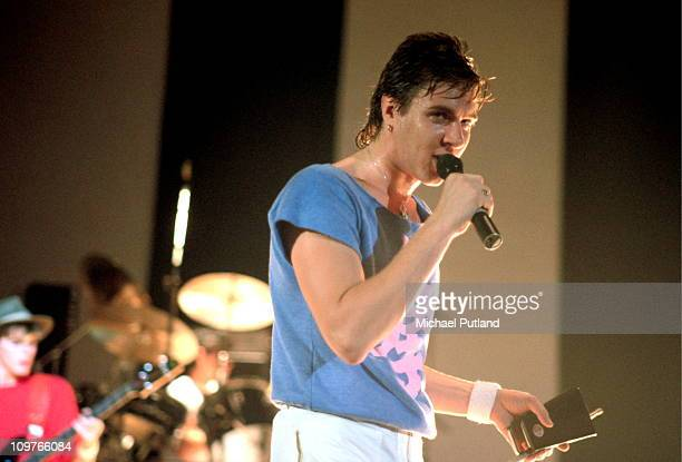 Lead singer Simon Le Bon of British band Duran Duran performing on stage in mid 1980's