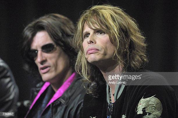 Lead singer Steve Tyler, right, and guitarist Joe Perry from the rock band Aerosmith listen to a question from the media during a press conference...