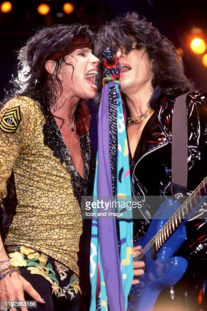 Lead singer Steven Tyler and lead guitarist Joe Perry of the American rock band Aerosmith sing on stage during the 1987 Permanent Vacation Tour on...