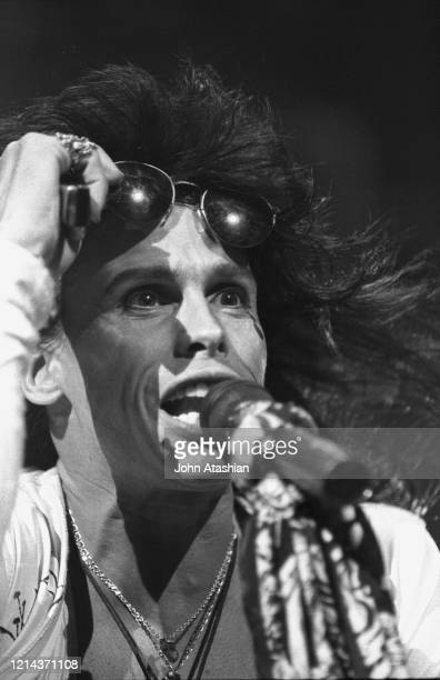 """Lead singer Steven Tyler of the rock band Aerosmith is shown performing on stage during a """"live"""" concert appearance on June 23, 1990."""