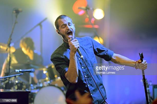 Lead Singer Tom Smith performs with the Editors on August 8 2013 in Frankfurt am Main Germany The indie rock band from Birmingham Editors presented...