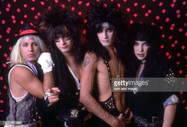 Lead singer Vince Neil bassist Nikki Sixx drummer Tommy Lee and lead guitarist Mick Mars of the American hard rock band Motley Crue pose for a studio...