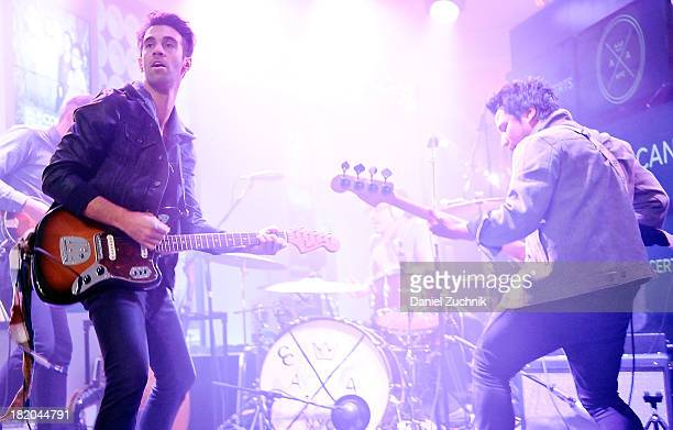 Lead singer Zachary Barnett and bassist David Rublin of American Authors perform during the 2013 MLB Fan Cave Concert Series at MLB Fan Cave on...