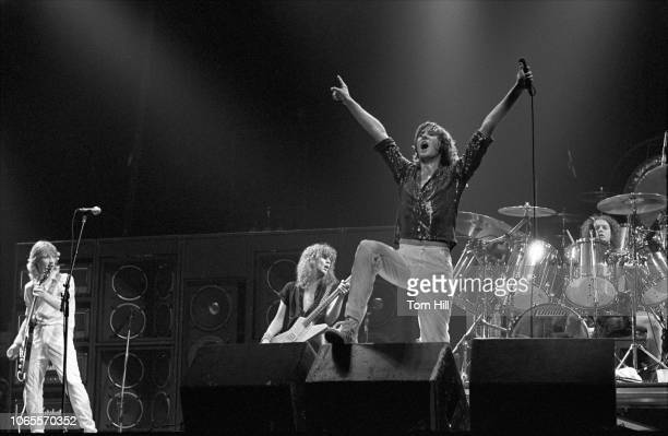 Lead songwriter and guitarist Steve Clark, bassist Rick Savage, lead singer Joe Elliott and drummer Rick Allen of Def Leppard perform at The Fabulous...