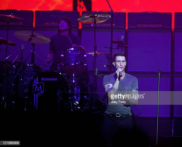 Lead Vocalist Adam Levine and Drummer Matt Flynn of Maroon 5 perform onstage at Conceso Fieldhouse on August 18 2011 in Indianapolis Indiana