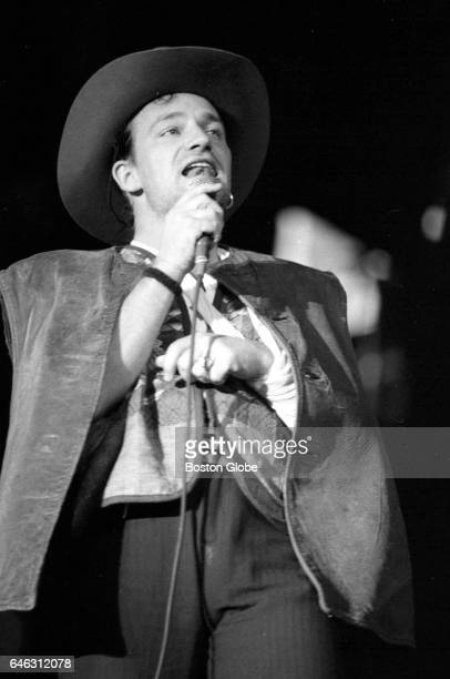 Lead vocalist Bono performs with U2 at Sullivan Stadium in Foxborough MA on Sep 22 1987 during the band's tour supporting The Joshua Tree