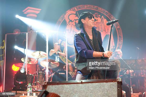 Lead vocalist Klaus Meine of German heavy metal band Scorpions performs during their 'MTV Unplugged Tour' at the Lanxess Arena on May 01 2014 in...