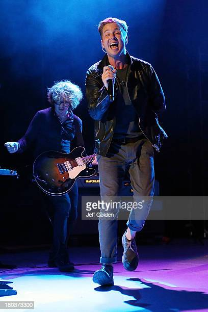 Lead vocalist Ryan Tedder and guitarist Drew Brown of OneRepublic perform at The Greek Theatre on September 11 2013 in Los Angeles California