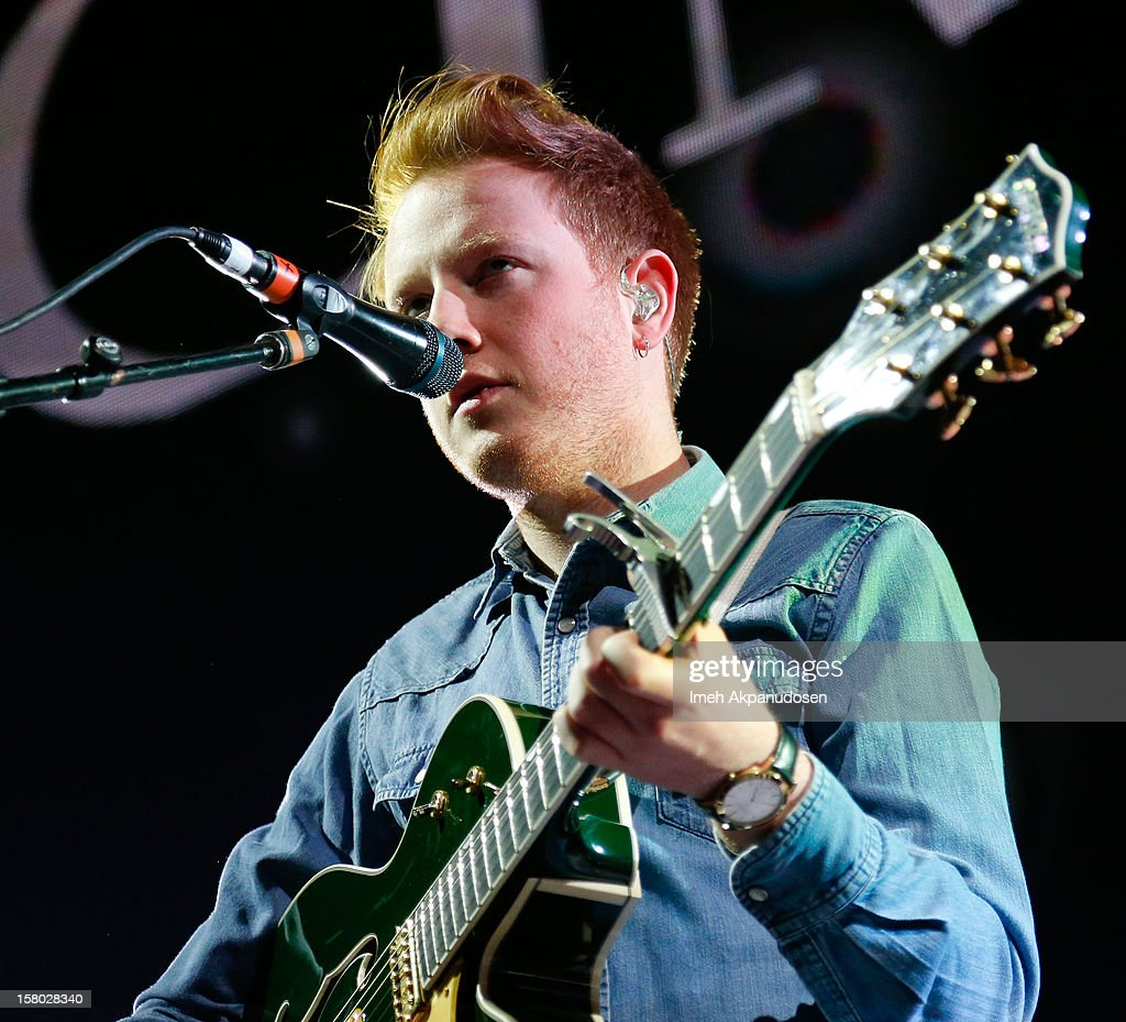 Lead vocalist/guitarist Alex Trimble of Two Door Cinema Club performs at the 23rd Annual KROQ Almost Acoustic Christmas at Gibson Amphitheatre on December 8, 2012 in Universal City, California.