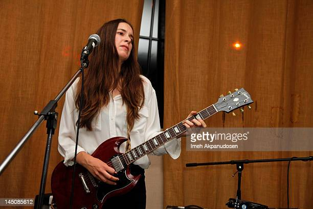Lead vocalist/guitarist Danielle Haim of HAIM performs at the Nudie Jeans event at the Palihouse on May 22 2012 in West Hollywood California