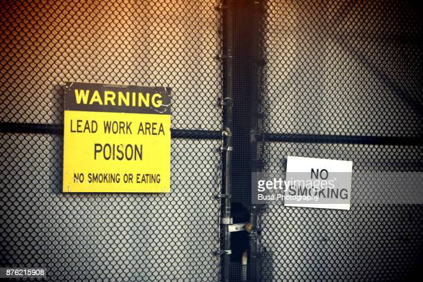 'Lead Work Area' Warning sign outside chain link fence in Manhattan, New York City