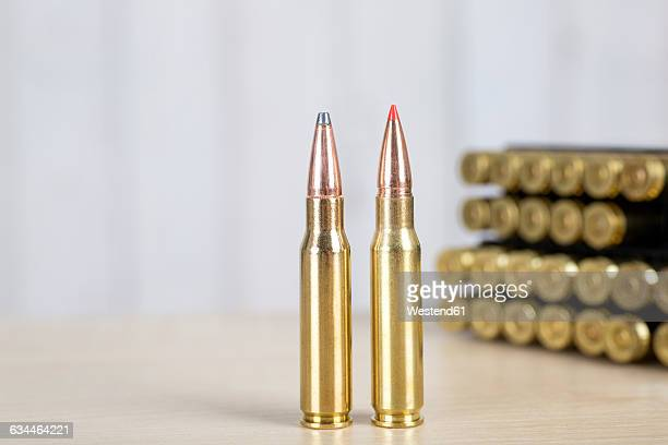 leaded and unleaded rifle ammunition, rifle cartridges - bullet stock photos and pictures
