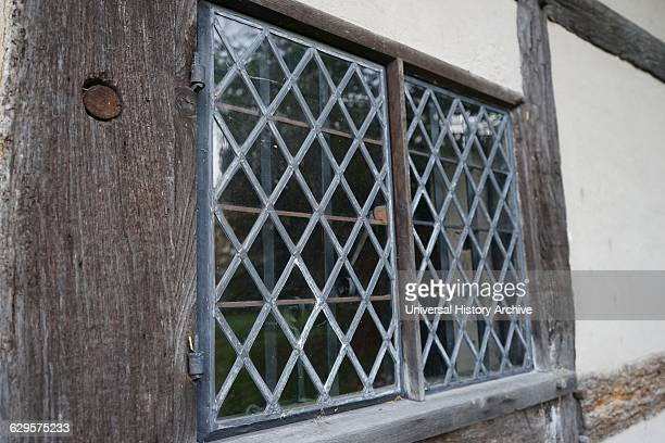 leaded window at Anne Hathaway's Cottage where Anne Hathaway the wife of William Shakespeare lived as a child StratforduponAvon England The earliest...