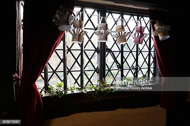 Leaded window inside Anne Hathaway's Cottage where Anne Hathaway the wife of William Shakespeare lived as a child StratforduponAvon England The...