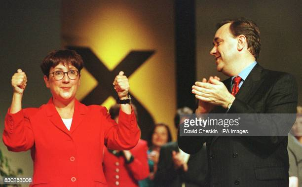 SNP leader Alex Salmond introduces the winner of the Hamilton byelection Annabelle Ewing after his keynote speech at the party conference in Inverness