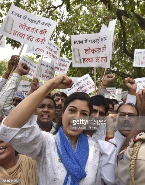 AAP leader Alka Lamba along with the supporters protests against the EVM machines used in the recent elections demanding VVPATequipped electronic...