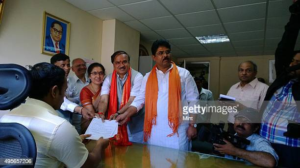 BJP leader Ananth Kumar files his nomination papers at the Bangalore Mahanagara Palike office against political newbie Nandan Nilekani for the...