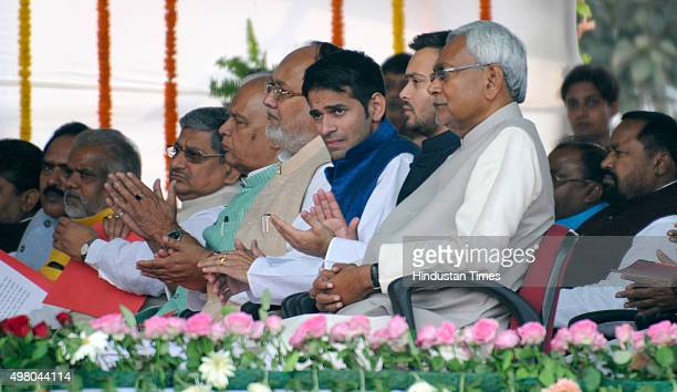 JDU leader and Bihar Chief Minister Nitish Kumar sitting with Tej Pratap Yadav and Tejaswi Yadav and other leaders before taking an oath at Gandhi...