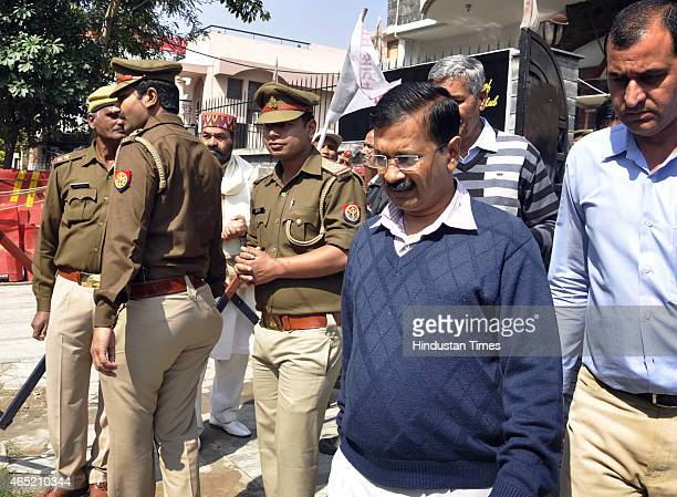 AAP leader and Delhi Chief Minister Arvind Kejriwal leaves after the public meeting at his party office Kaushambi area on March 4 2015 in Ghaziabad...