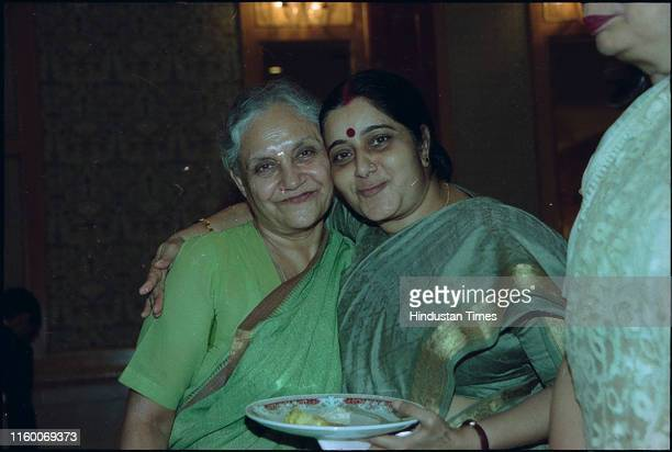 BJP leader and former Delhi Chief Minister Sushma Swaraj with Congress leader and Delhi Chief Minister during Lieutenant Governor Hosted Party on...