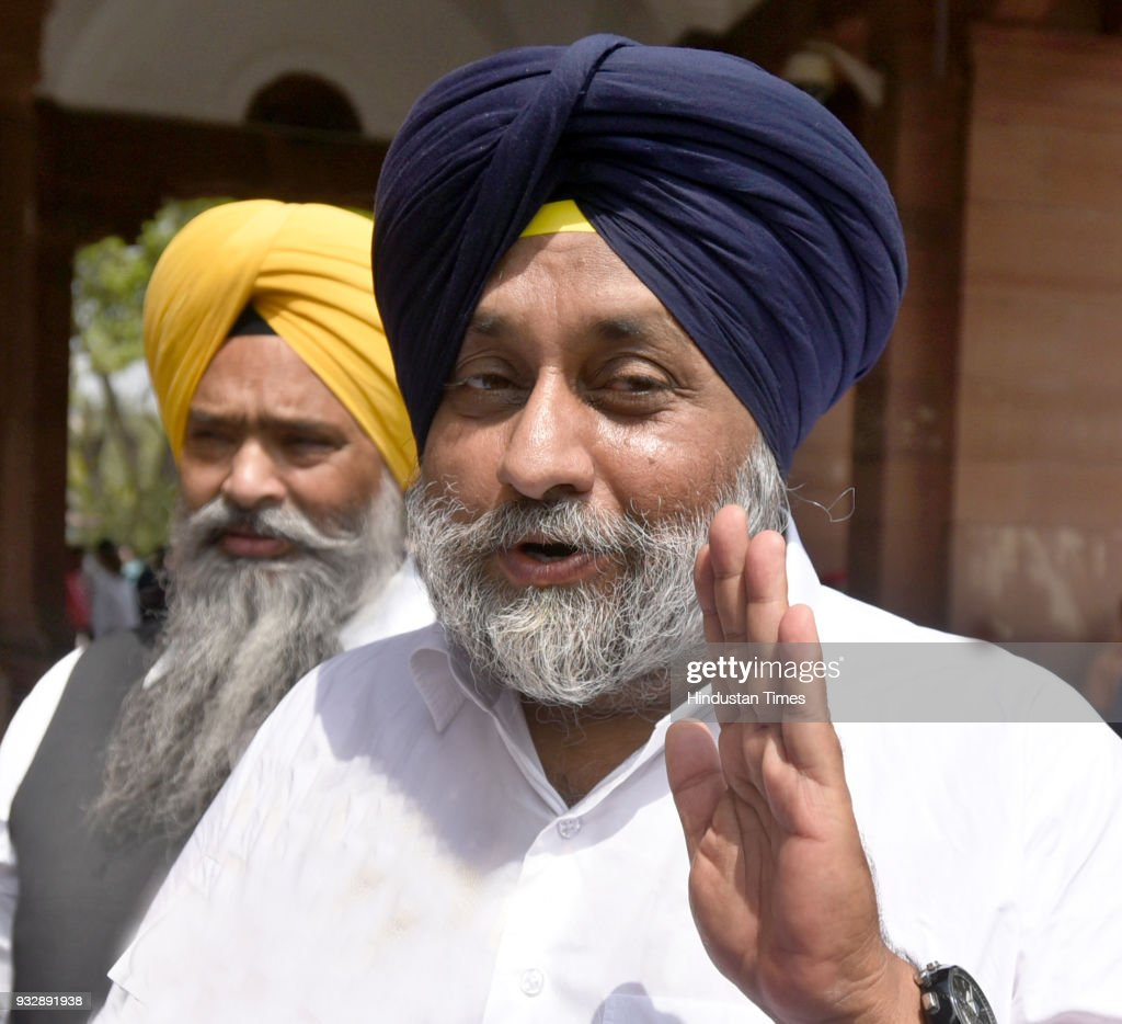 SAD leader and former Deputy Chief Minister of Punjab Sukhbir Singh Bada and party MP Prem Singh Chandumajra during the Parliament session at...
