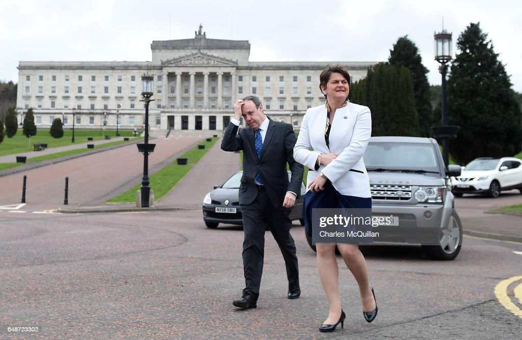 DUP leader and former First Minister Alene Foster arrives alongside Nigel Dodds for a press call at Stormont on March 6, 2017 in Belfast, Northern Ireland. Elected MLA's return today after last weeks elections with the two largest parties, Sinn Fein and the Democratic Unionist party commencing talks to form a new power sharing executive government. Sinn Fein northern leader Michelle O'Neill has stated that there can be no agreement if former First Minister Arlene Foster of the DUP is nominated again for the position.