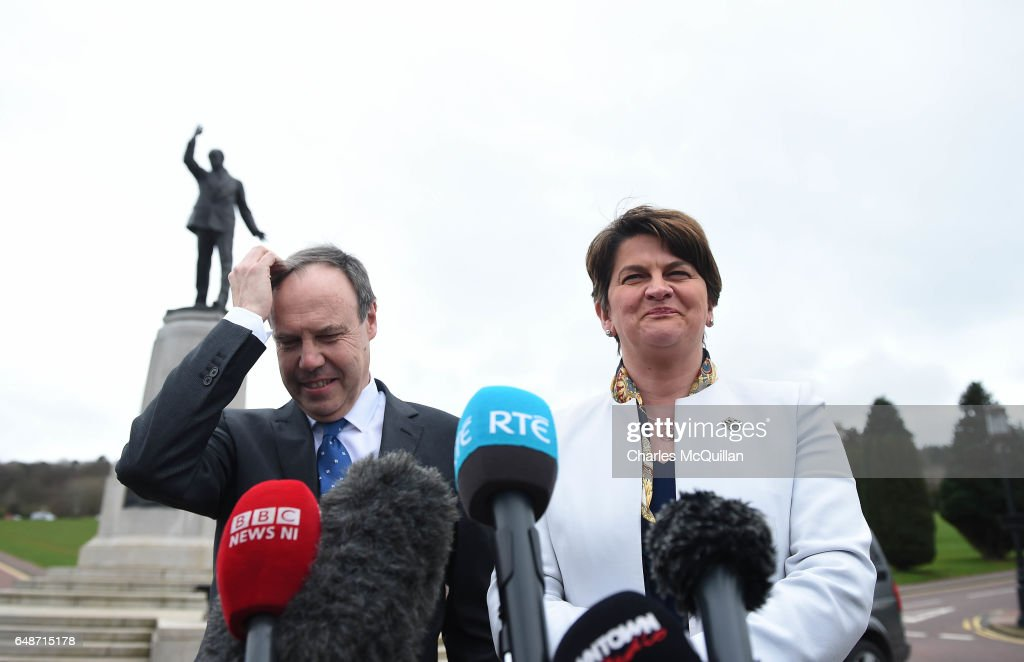DUP leader and former First Minister Alene Foster (R) talks to the gathered media alongside Nigel Dodds (L) during a press call at Stormont on March 6, 2017 in Belfast, Northern Ireland. Elected MLA's return today after last weeks elections with the two largest parties, Sinn Fein and the Democratic Unionist party commencing talks to form a new power sharing executive government. Sinn Fein northern leader Michelle O'Neill has stated that there can be no agreement if former First Minister Arlene Foster of the DUP is nominated again for the position.