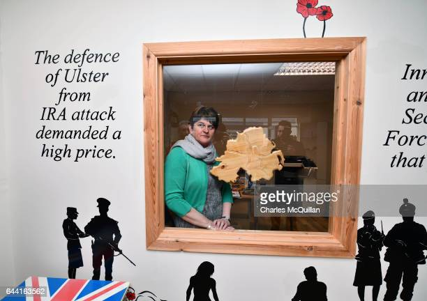DUP leader and former First Minister Arlene Foster looks through a window at a conflict museum during her campaign trail on February 23 2017 in...