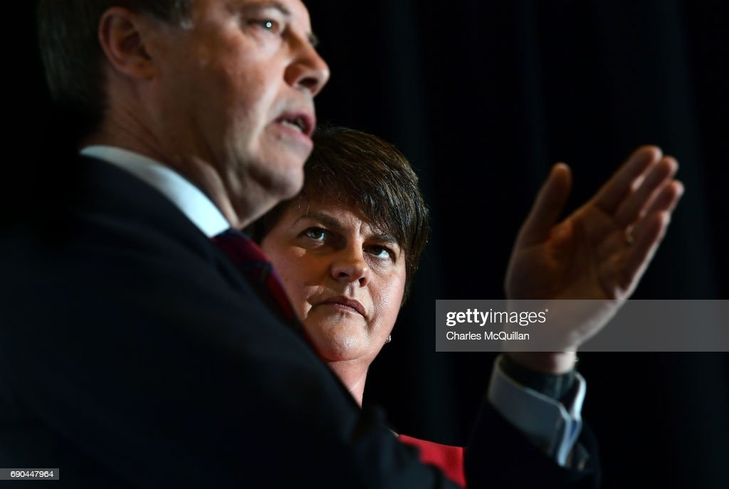 DUP leader and former First Minister Arlene Foster (R) watches DUP deputy leader Nigel Dodds (L) addressing the gathered media as the Democratic Unionist party launch their manifesto at the Old Courthouse on May 31, 2017 in Antrim, Northern Ireland. Candidates for the general election face an uncertain campaign against the backdrop of Brexit, Northern Ireland provides the only hard border between the UK and Europe and also the Stormont Assembly's ongoing stalemate due to the political deadlock between the local parties.