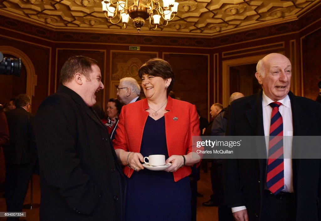 DUP leader and former Northern Ireland First Minister Arlene Foster (C) jokes with party members before the Democratic Unionist Party election launch at Brownlow House on February 6, 2017 in Lurgan, Northern Ireland. Northern Ireland voters will go to the polls on March 2nd following the collapse of the Assembly government at Stormont. This snap election was triggered when the then Deputy First Minister Martin McGuinness resigned his position following the Renewable Heat Incentive scheme crisis which could cost up to 490 million pounds to the Northern Ireland tax payer.