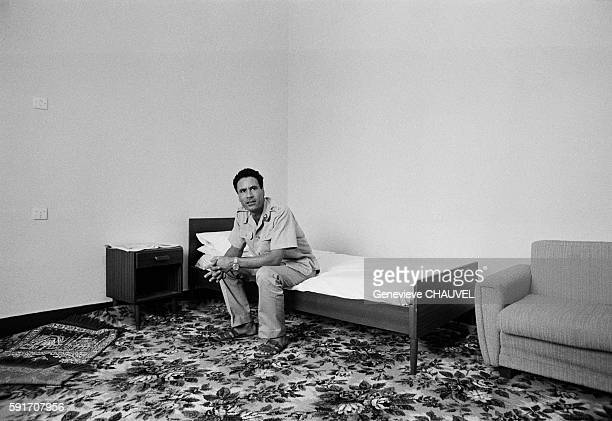 Leader and Guide of the Revolution of Libya Muammar alGaddafii sitting on a small bed in his home in Tripoli