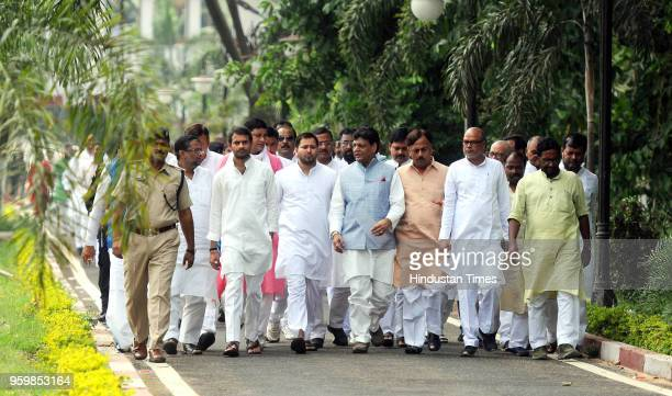RJD leader and Lalu Prasad's son Tejashwi Prasad Yadav along with party legislators after meeting with Governor Satyapal Malik and submitting letters...