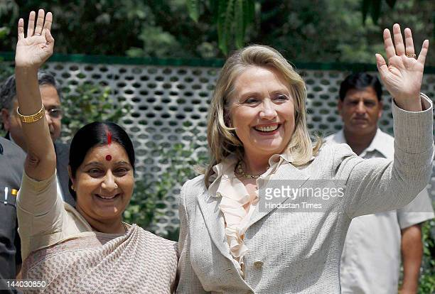 BJP leader and Leader of Opposition in Lok Shabha Sushma Swaraj and US Secretary of State Hillary Clinton wave to media before a meeting at Sushma's...