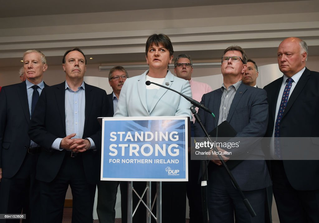 DUP leader and Northern Ireland former First Minister Arlene Foster (C) holds a brief press conference with the DUP's newly elected Westminster candidates who stood in the general election on June 9, 2017 in Belfast, Northern Ireland. After a snap election was called by Prime Minister Theresa May the United Kingdom went to the polls yesterday. The closely fought election has failed to return a clear overall majority winner and a hung parliament has been declared. Arlene Foster and the Democratic Unionist party with their ten Westminster seats have today stated that they will back Theresa May and the Conservatives in a prop up goverment. The two parties will continue talks about the finer details of the arrangement.