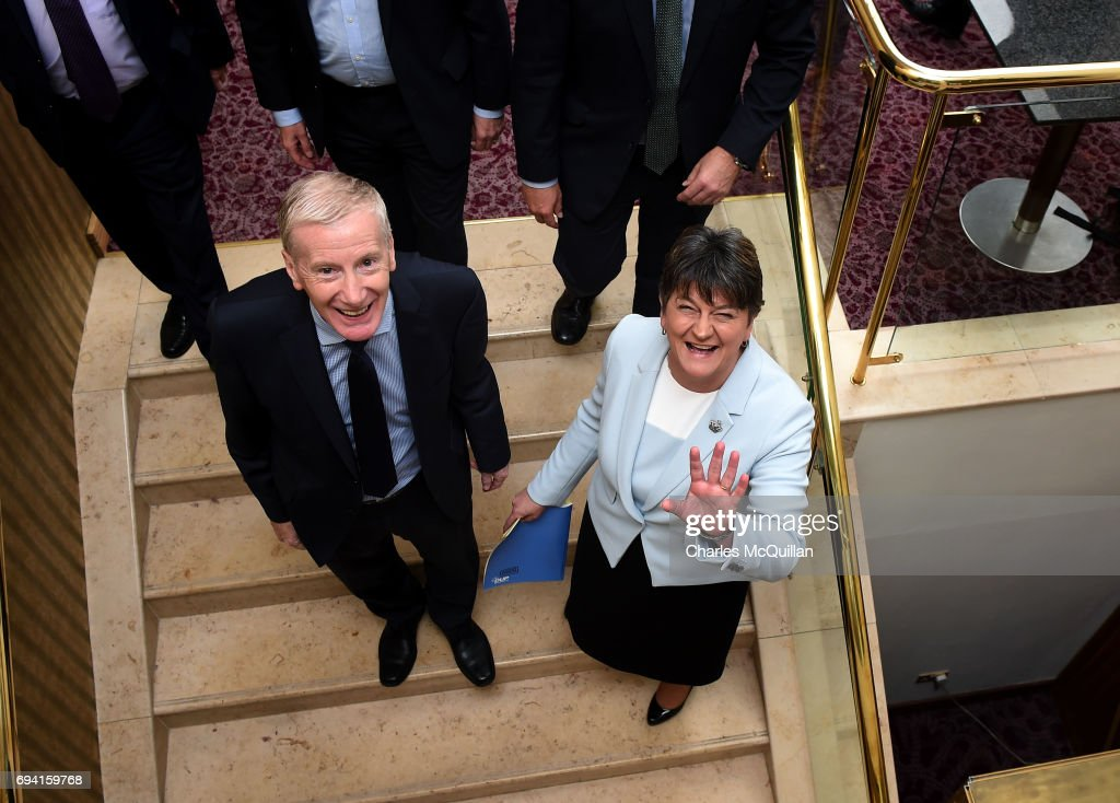 DUP leader and Northern Ireland former First Minister Arlene Foster (R) waves to the media alongside Gregory Campbell (L) after holding a press conference with the DUP's newly elected Westminster candidates who stood in the general election on June 9, 2017 in Belfast, Northern Ireland. After a snap election was called by Prime Minister Theresa May the United Kingdom went to the polls yesterday. The closely fought election has failed to return a clear overall majority winner and a hung parliament has been declared. Arlene Foster and the Democratic Unionist party with their ten Westminster seats have today stated that they will back Theresa May and the Conservatives in a prop up goverment. The two parties will continue talks about the finer details of the arrangement.