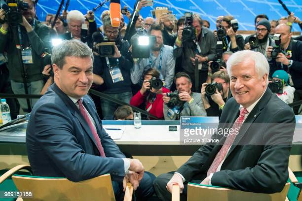CSU leader and premier of Bavaria Horst Seehofer and Bavarian Finance Minister Markus Soeder sitting next to each other at the CSUparty conference...