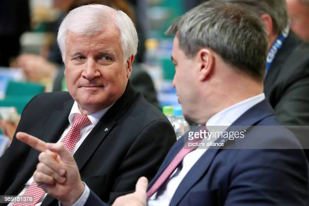 CSU leader and premier of Bavaria Horst Seehofer and Bavarian Finance Minister Markus Soeder sitting next to each other at the CSU party conference...