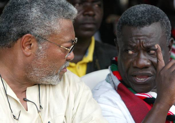 NDC leader and presidential election candidate Pr John Atta Mills talks to former Ghanaian President Jerry Rawlings during a meeting in Accra 04...
