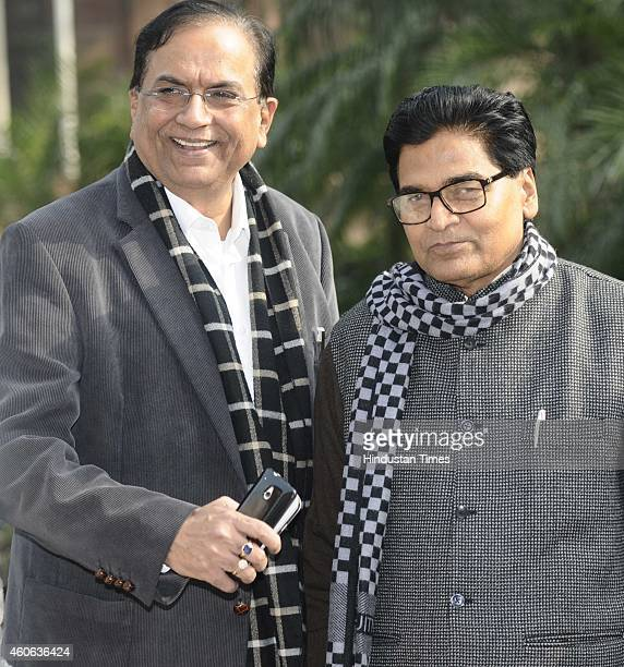 SP leader and Rajya Sabha MP Ram Gopal Yadav with BSP General Secretary Satish Chandra Misra during the Parliament winter session on December 18 2014...