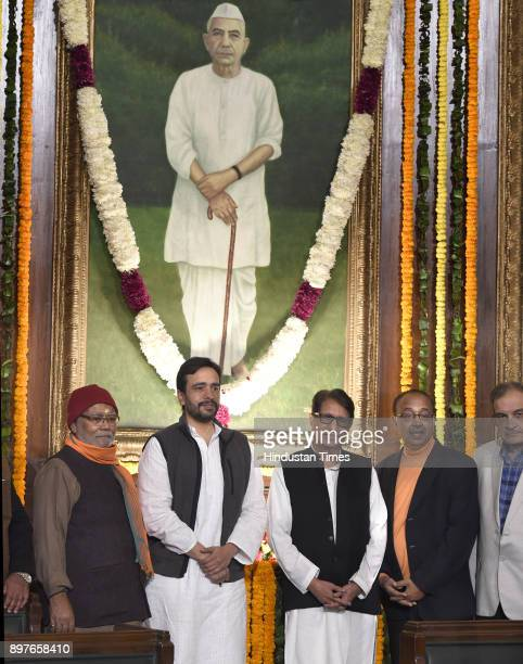 Leader and Union Ministers Vijay Goel RLD leaders Ajit Singh Jayant chaudhary and others during paying floral tributes on the portrait of former...