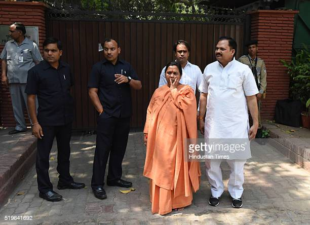 BJP leader and Water Resource Minister Uma Bharati arrives to pay her respect to Kamla Advani wife of BJP leader LK Advani at his residence at...