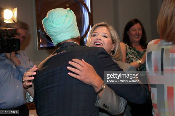 Leader Andrea Horwath hugs Brampton East MPP Gurratan Singh on arriving to a meeting with her 40member caucus for the first time