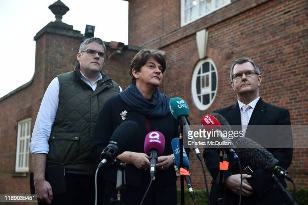 Leader Arlene Foster addresses the media outside Stormont House alongside party members Gavin Robinson and Jeffrey Donaldson as cross party talks to...